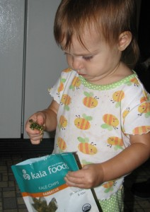 Little Girl eating kale chips