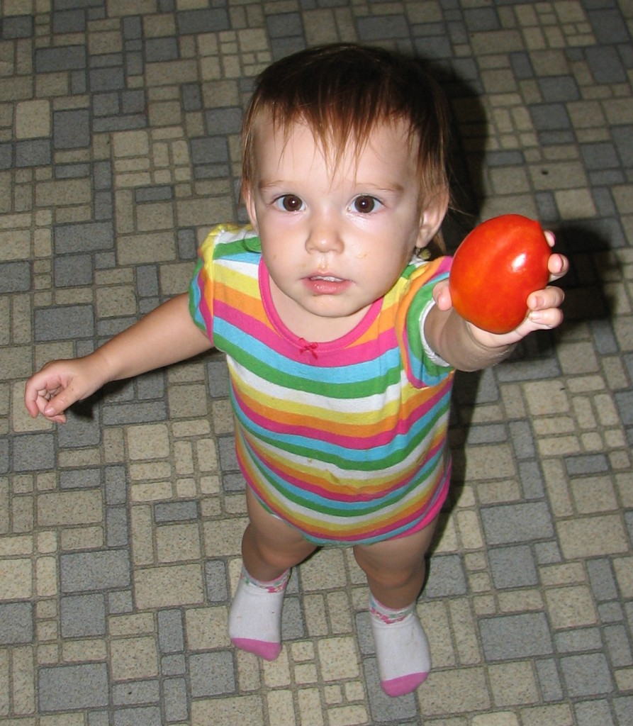 Little Girl with tomato